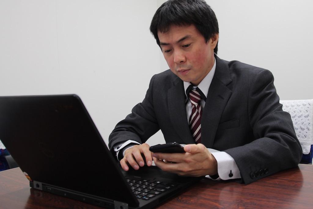 国際自動車(kmタクシー)初のアプリフルクル開発者 澤井さんの写真