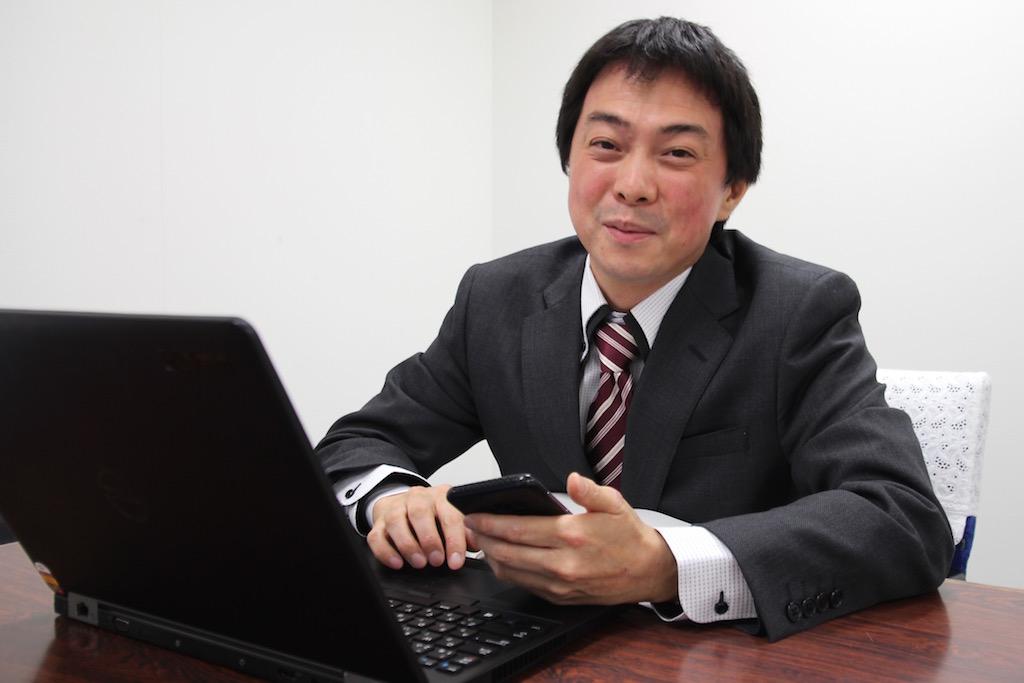 国際自動車(kmタクシー)初のアプリフルクル開発者 IT課係長の澤井さん
